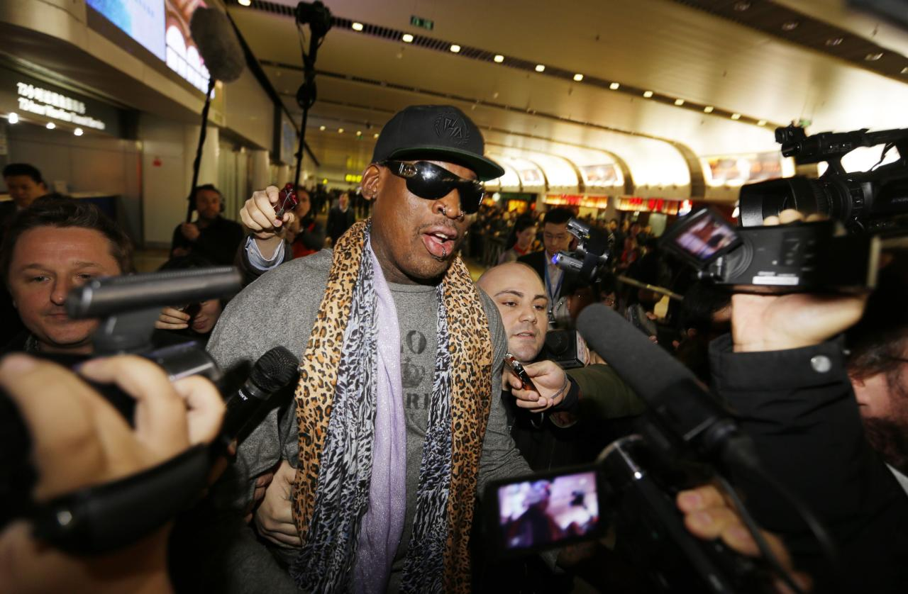 Former NBA basketball player Dennis Rodman speaks to the media after returning from his trip to North Korea at Beijing airport, December 23, 2013. REUTERS/Jason Lee (CHINA - Tags: POLITICS SPORT TPX IMAGES OF THE DAY)