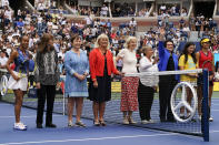 Members of the Original 9 pose for a photo with Leylah Fernandez, of Canada, far left, and Emma Raducanu, of Britain, far right before the start of the women's singles final of the US Open tennis championships, Saturday, Sept. 11, 2021, in New York. (AP Photo/Elise Amendola)