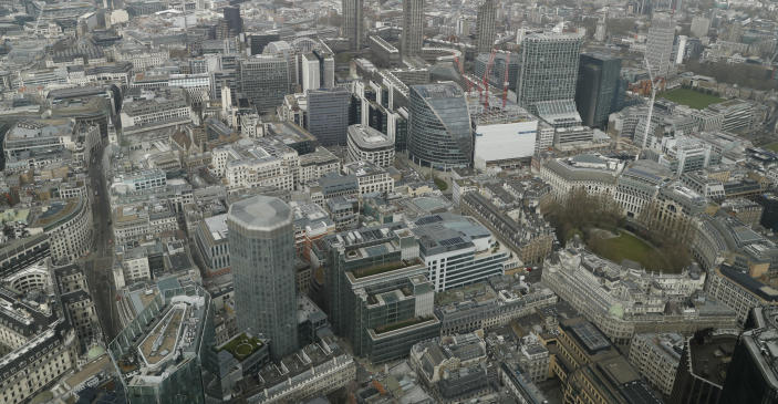 A view over the City of London from the 59th floor of 22 Bishopsgate in London, Thursday, April 1, 2021. (AP Photo/Alastair Grant)