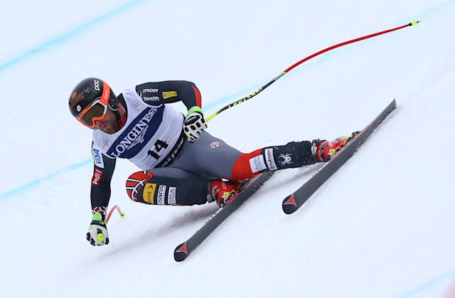Travis Ganong of the United States speeds down the course on his way to take the fourth place at an alpine ski, men's World Cup downhill, in Kvitfjell, Norway, Saturday, March 1, 2014. (AP Photo/Alessandro Trovati)