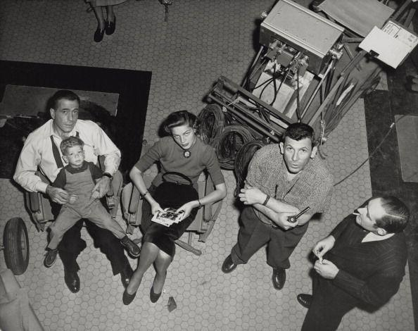 <p>With parents that were just as beloved on-screen as they were off-screen, it's no wonder Stephen Bogart was comfortable on a movie set. Here, he lounges on his father's lap, while his parents are on a break from acting. </p>