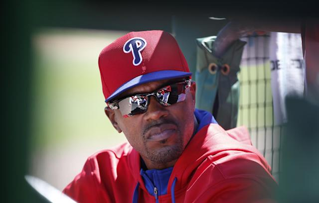 Philadelphia Phillies Jimmy Rollins sits in the dugout during a spring exhibition baseball game against the New York Yankees in Clearwater, Fla., Thursday, March 13, 2014. Rollins, who did not play for the third consecutive game, said the situation was unusual and that he is healthy, therefore he is not sure why manager Ryne Sandberg is not playing him. (AP Photo/Kathy Willens)