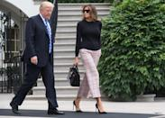 """<p>Melania Trump wore plaid Valentino trousers for the first day of her second international trip with the president. She carried with her a crocodile-skinned Birkin bag (<a href=""""https://www.townandcountrymag.com/style/fashion-trends/a9956043/birkin-bag-auction-hong-kong/"""" rel=""""nofollow noopener"""" target=""""_blank"""" data-ylk=""""slk:a iconic style"""" class=""""link rapid-noclick-resp"""">a iconic style</a>), and a pair of black visor sunglasses to match. </p>"""