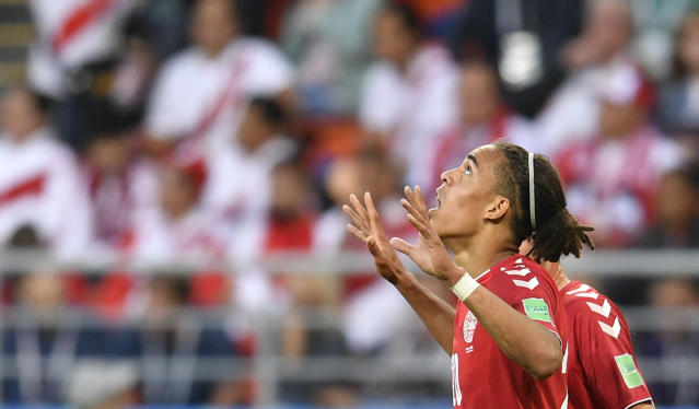 Denmark's Yussuf Yurary Poulsen celebrates after scoring during the group C match between Peru and Denmark at the 2018 soccer World Cup in the Mordovia Arena in Saransk, Russia, Saturday, June 16, 2018. (AP Photo/Martin Meissner)