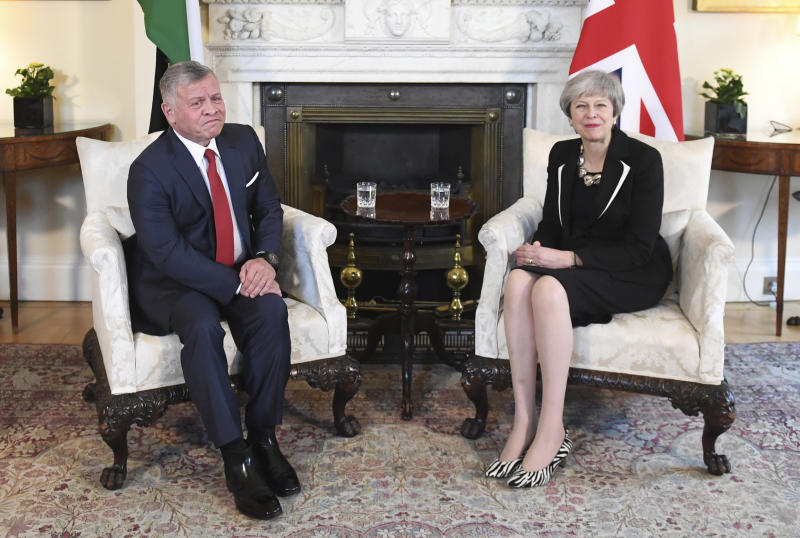 Britain's Prime Minister Theresa May and King Abdullah II of Jordan pose for a photo inside 10 Downing Street in London, Thursday Feb. 28, 2019. (Stefan Rousseau/PA via AP)