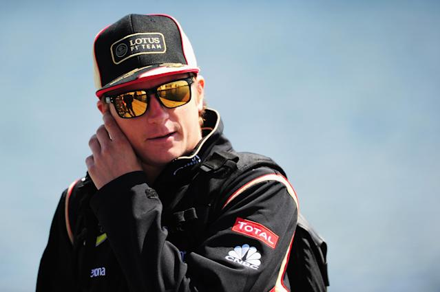 MONTREAL, QC - JUNE 09: Kimi Raikkonen of Finland and Lotus arrives in the paddock before the Canadian Formula One Grand Prix at the Circuit Gilles Villeneuve on June 9, 2013 in Montreal, Canada. (Photo by Shaun Botterill/Getty Images)