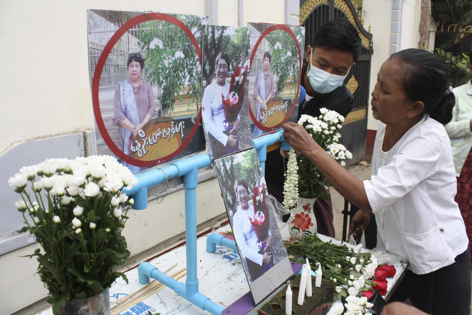 People prepare for a memorial service as a tribute to a teacher who died in a protest on Feb 28, in Yangon, Myanmar, Monday, March 1, 2021. (AP Photo)