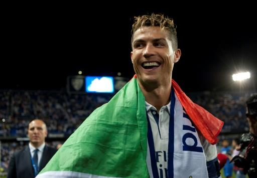 Real Madrid forward Cristiano Ronaldo celebrates winning the Spanish league title in Malaga on May 21, 2017