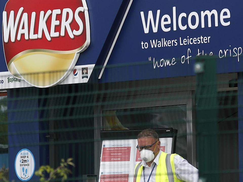 A man exits the Walkers Crisps factory that has confirmed cases of coronavirus amongst its workers in Leicester: Darren StaplesGetty Images
