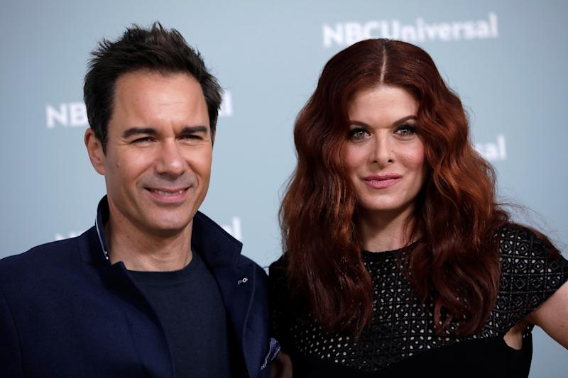 "Actors Eric McCormack and Debra Messing from the NBC series ""Will & Grace"" pose for photographers at the NBCUniversal UpFront presentation in New York City, New York, U.S., May 14, 2018. REUTERS/Mike Segar"