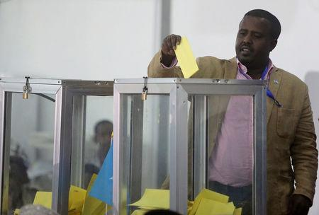 A Somali lawmaker casts his ballot during the presidential vote at the airport in Somalia's capital Mogadishu, February 8, 2017. REUTERS/Feisal Omar