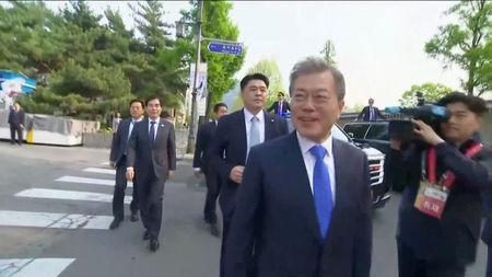 South Korean President Moon Jae-in greets supporters in Seoul, as he makes his way to the inter-Korean summit, in this still frame taken from video, April 27, 2018. Host Broadcaster via REUTERS TV