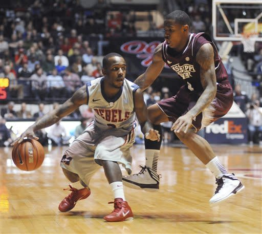 Mississippi's Derrick Millinghaus, left, is defended by Mississippi State's Trivante Bloodman (4) during anNCAA college basketball game Wednesday, Feb. 6, 2013, in Oxford, Miss. (AP Photo/Oxford Eagle, Bruce Newman)