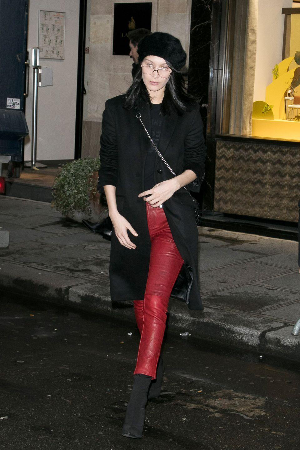 <p>In a black tee, Givenchy coat, Frame leather pants, and black booties paired with a Charlotte Simone beret and Carrera frames while out in Paris. </p>