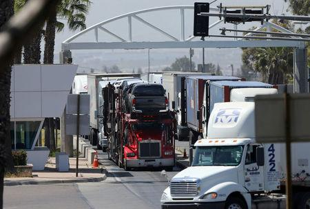 FILE PHOTO: A transport truck carries new Toyota trucks through an inspection station after clearing U.S. customs from Mexico at the border in Otay Mesa near San Diego, California, U.S. on April 28, 2017.   REUTERS/Mike Blake/File Photo
