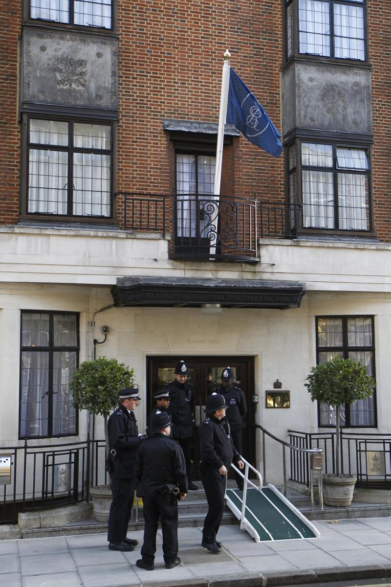 CORRECTS SECOND SENTENCE FILE- In this Tuesday, Dec. 4, 2012 file photo, police Officers stand guard outside the King Edward VII hospital in central London where Kate, the Duchess of Cambridge has been admitted with a severe form of morning sickness. King Edward VII hospital says a nurse involved in a prank telephone call to elicit information about the Duchess of Cambridge has died. The hospital said Friday, Dec. 7, 2012 that Jacintha Saldanha had been a victim of the call made by two Australian radio disc jockeys. They did not immediately say what role she played in the call. (AP Photo/Sang Tan, File)