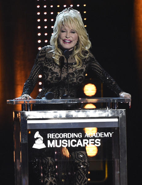 CORRECTS YEAR TO 2019 - Dolly Parton accepts her award at MusiCares Person of the Year on Friday, Feb. 8, 2019, at the Los Angeles Convention Center. (Photo by Chris Pizzello/Invision/AP)