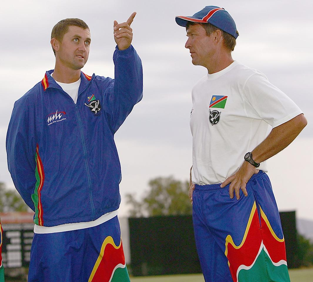 WINDHOEK, NAMIBIA - NOVEMBER 19: Andy Waller (R), coach of The Namibian Cricket team chats with captain Deon Kotze head of the tour match against England on November 19, 2004 in Windhoek, Namibia. (Photo by Julian Herbert/Getty Images)