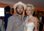 """<p>The actress and model married film producer Rick Salomon on 29 September 2008 after the pair became engaged earlier that month. She later separated from Salomon on 13 December, and requested an annulment on 22 February 2008. The pair married each other again on an unspecified date between 2013 and 2014, but <a href=""""https://www.dailymail.co.uk/tvshowbiz/article-3009088/Pamela-Anderson-divorcing-Rick-Salomon-not-compatible-sexually-bored.html"""" rel=""""nofollow noopener"""" target=""""_blank"""" data-ylk=""""slk:it ended in divorce"""" class=""""link rapid-noclick-resp"""">it ended in divorce</a> on 29 April 2015.<em> [Photo: Getty]</em> </p>"""