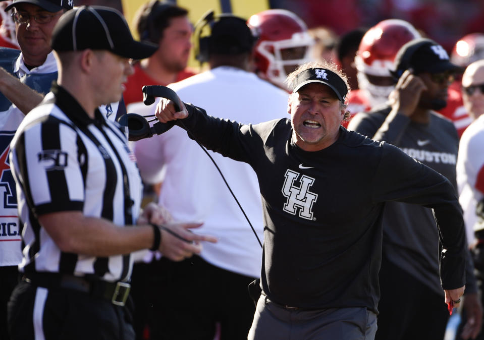 Houston head coach Dana Holgorsen, right, yells at an official during the second half of an NCAA college football game against Cincinnati, Saturday, Oct. 12, 2019, in Houston. (AP Photo/Eric Christian Smith)