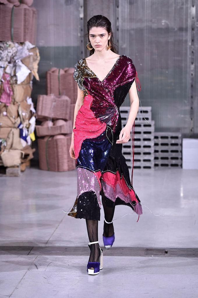 <p>A model wears a color-block sequined dress at the Marni FW18 show. (Photo: Getty) </p>