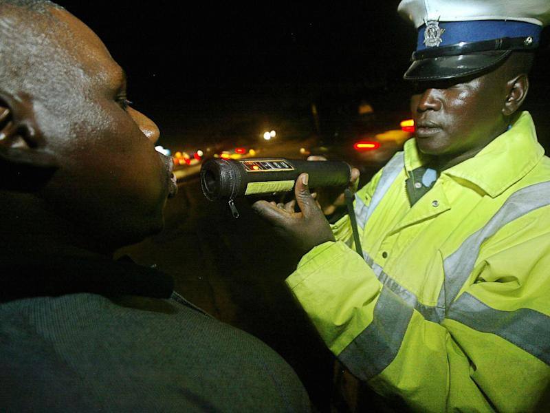 A Kenyan police officer administers a breathalyser test to a driver in Nairobi: TONY KARUMBA/AFP/Getty Images