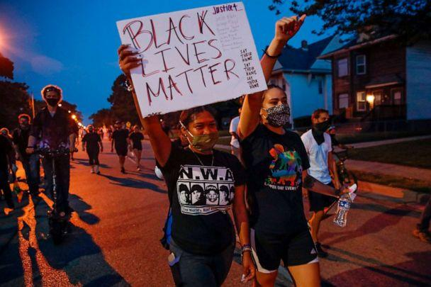 PHOTO: A protester holds a 'Black Lives Matter' sign during a demonstration against the police shooting of Jacob Blake in Kenosha, Wisconsin, on Aug. 26, 2020. (Kamil Krzaczynski/AFP via Getty Images)
