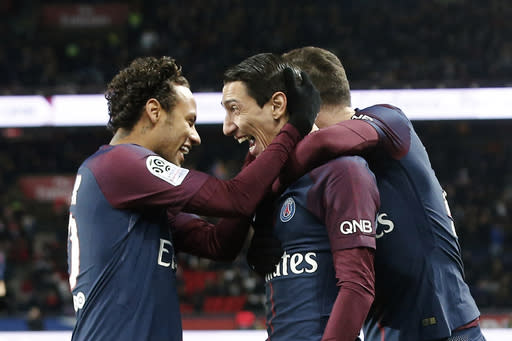 <p>PSG's Angel Di Maria, center right, celebrates with PSG's Neymar, after scoring during his French League One soccer match between Paris-Saint-Germain and Dijon, at the Parc des Princes stadium in Paris, France, Wednesday, Jan.17, 2018. (AP Photo/Thibault Camus) </p>