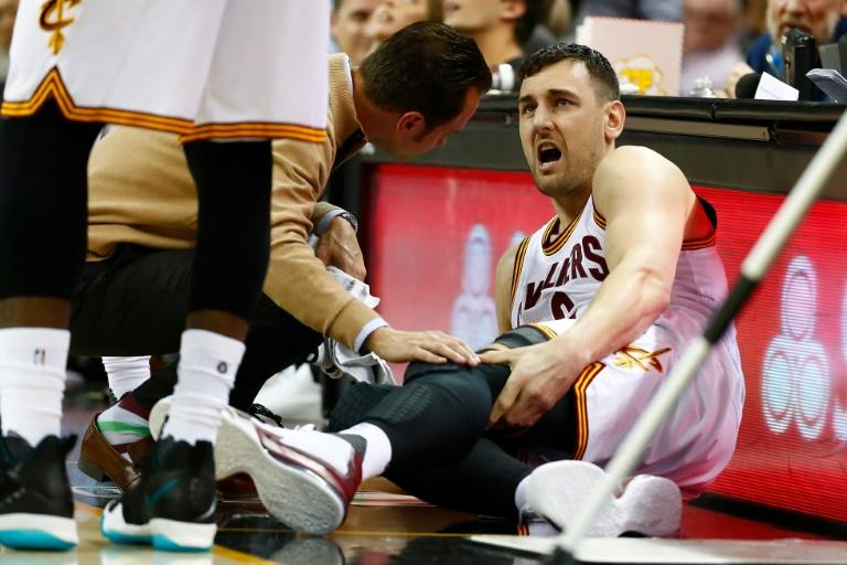 Andrew Bogut of the Cleveland Cavaliers grimaces in pain after breaking his left leg in the first half while playing the Miami Heat, at Quicken Loans Arena in Cleveland, Ohio, on March 6, 2017