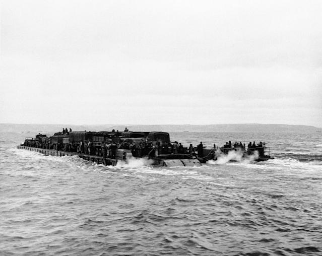 <p>A view of a Rhino ferry on its way loaded down with men, supplies and trucks on June 7, 1944. Rhino ferries, self-propelled pontoons staffed by Seabees (members of a Navy construction battalion), are being used in the invasion. (Photo: AP) </p>