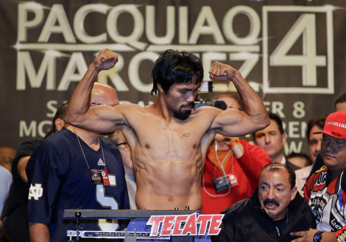 Manny Pacquiao poses for photos during the weigh-in for his welterweight fight against Juan Manuel Marquez, Friday, Dec. 7, 2012, in Las Vegas. Pacquiao will take on Marquez on Saturday in Las Vegas. (AP Photo/Julie Jacobson)