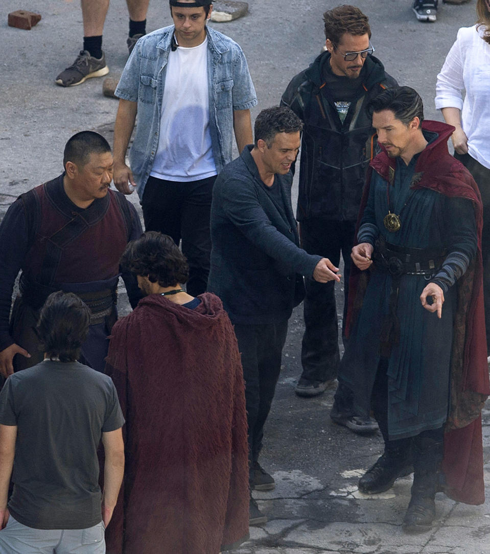 "<p>Cast members Mark Ruffalo, center, Robert Downey Jr., second right, and Benedict Cumberbatch, right, speak as actor Benedict Wong, left, looks on during the filming of ""Avengers: Infinity War,"" Monday, June 26, 2017, in Atlanta. The film is expected in theaters in May 2018. (AP Photo/Mike Stewart) </p>"