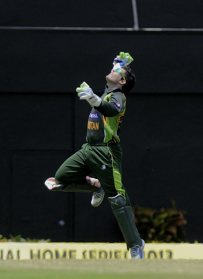 Pakistan wicket-keeper Umar Akmal celebrates catching West indies batsman Chris Gayle off bowler Junaid Khan for 21 runs during the 5th and final ODI West Indies v Pakistan on July 24, 2013 at Beausejour Cricket Ground, in Gros Islet, St. Lucia.  AFP PHOTO/RANDY BROOKS        (Photo credit should read RANDY BROOKS/AFP/Getty Images)
