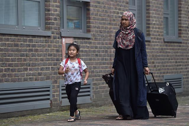<p>Residents are evacuated from the Dorney Tower residential block as a precautionary measure following concerns over the type of cladding used on the outside of the building on the Chalcots Estate in north London, Britain, June 24, 2017. (Photo: Hannah McKay/Reuters) </p>