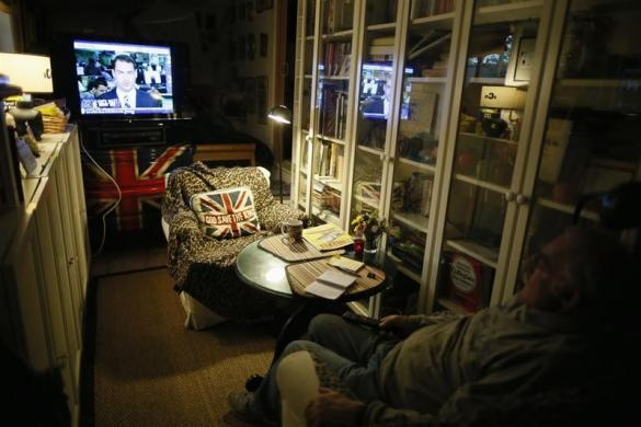 Ted Schorling, 76, watches television in Village Trailer Park in Santa Monica, July 12, 2012.