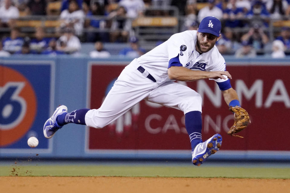 Los Angeles Dodgers shortstop Chris Taylor fields a ball hit by San Francisco Giants' Steven Duggar during the fifth inning of a baseball game Monday, July 19, 2021, in Los Angeles. Duggar was thrown out st first on the play. (AP Photo/Mark J. Terrill)