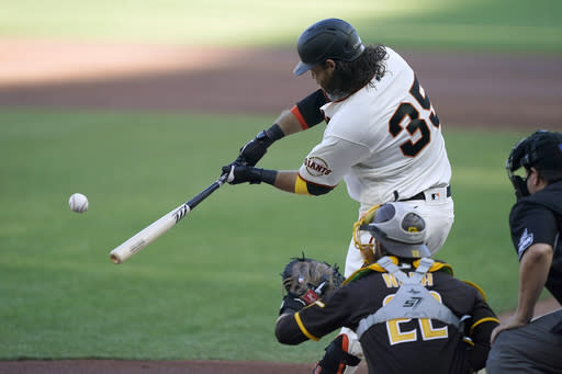 San Francisco Giants' Brandon Crawford hits a solo home run against the San Diego Padres during the second inning of the first game of a baseball doubleheader Friday, Sept. 25, 2020, in San Francisco. (AP Photo/Tony Avelar)
