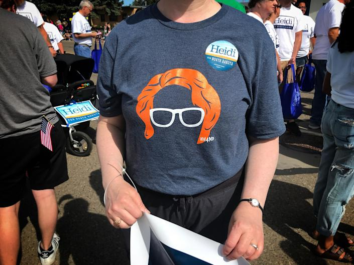 A supporter wears a shirt featuring Sen. Heidi Heitkamp's famous red hair during a parade in Dickinson, N.D. (Photo: Holly Bailey/Yahoo News)