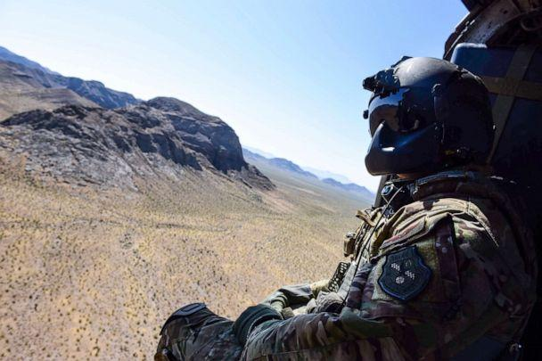 PHOTO: Staff Sgt. Christian Nault, 34th Weapons Squadron special mission aviator, searches the area for the landing zone during a Weapons School Integration mission at the Nevada Test and Training Range June 1, 2017. (Airman 1st Class Andrew Sarver/U.S. Air Force)