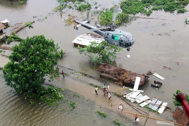 This handout photograph received from the Press Information Bureau (PIB) and taken on July 1, 2012 shows an Indian Air Force (IAF) helicopter on a Relief and Rescue mission in the flood-affected areas of Assam.  At least 79 people have died and 2.2 million forced to leave their homes over the last week as torrential monsoon rains triggered floods across India's northeast, officials said on July 2, 2012.