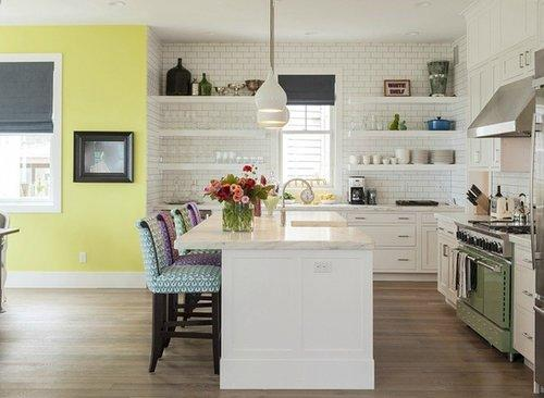 The neutral kitchen gets an unexpected perk with neon painted walls - a smart choice for an adjoining breakfast nook.  Source: Windermere Real Estate