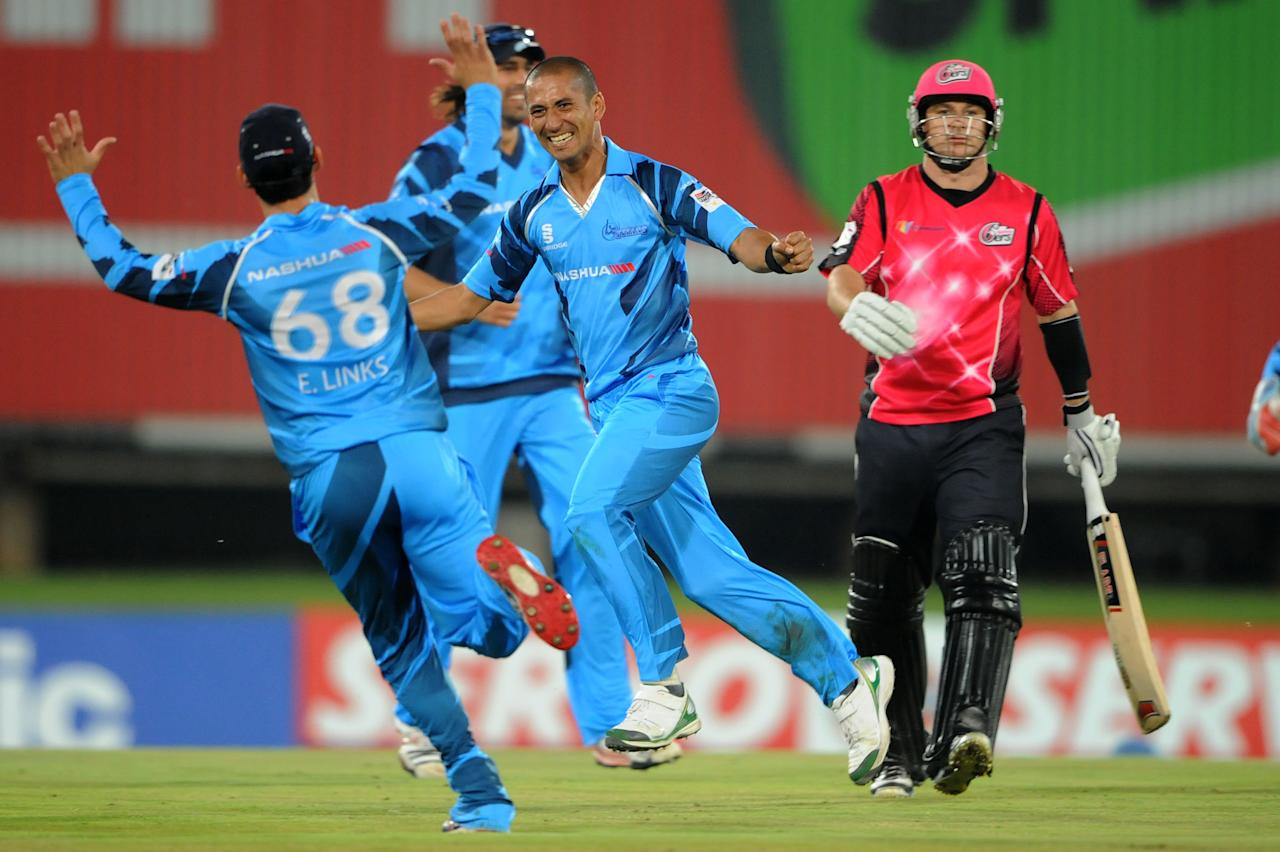 PRETORIA, SOUTH AFRICA - OCTOBER 26: (SOUTH AFRICA OUT) Alfonso Thomas of Nashua Titans celebrates the wicket of Nathan McCullum of Sydney Sixers during the Karbonn Smart CLT20 Semi Final match between Nashua Titans and Sydney Sixers at SuperSport Park on October 26, 2012 in Pretoria, South Africa. (Photo by Lee Warren/Gallo Images/Getty Images)