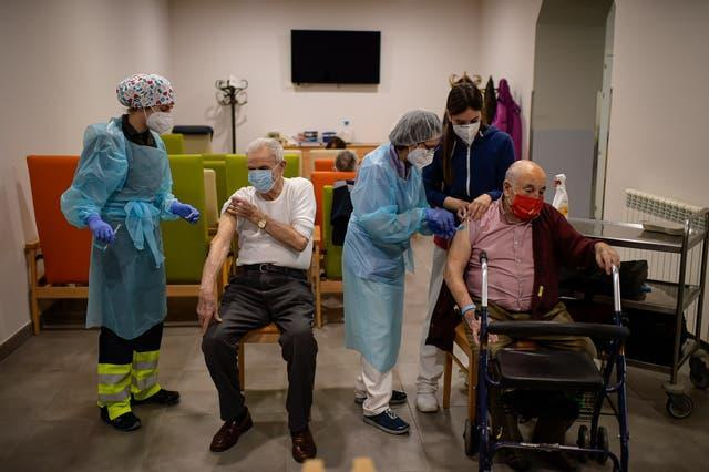Residents are vaccinated with the second Pfizer coronavirus vaccine at San Jeronimo nursing home in Estella, around 38km (23 miles) from Pamplona, northern Spain
