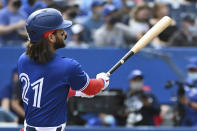 Toronto Blue Jays' Bo Bichette watches his three-run home run in the first inning in the first inning of a baseball game against the Tampa Bay Rays in Toronto on Wednesday, Sept. 15, 2021. (Jon Blacker/The Canadian Press via AP)