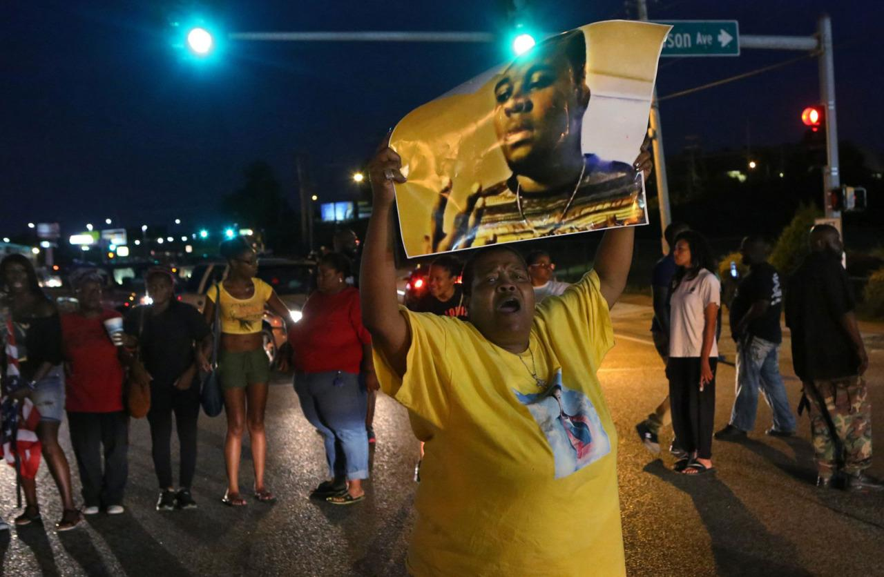 <p>Shots fired during a protest in Ferguson, Mo., on the 2nd anniversary of Michael Brown's death</p><p>Sharon Cowan chants Sharon Cowan chants as she marches Tuesday, Aug. 9, 2016, in Ferguson, Mo., on the second anniversary of the death of Michael Brown, an unarmed black 18-year-old who was shoot by a white police officer. (J.B. Forbes/St. Louis Post-Dispatch via AP)</p>