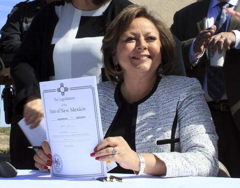 New Mexico Gov. Susana Martinez holds signed legislation that expands access to the overdose antidote naloxone during a ceremony at a substance abuse treatment center for youth in Albuquerque, N.M., on Thursday, April 6, 2017. With the signing, New Mexico becomes the first state to require all state and local law enforcement officers to be equipped with naloxone. The measure also requires treatment clinics to educate their patients and provide two doses of naloxone and a prescription for the overdose-reversal drug. (AP Photo/Susan Montoya Bryan)