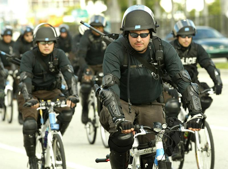 Riot police ride bicycles on Biscayne Boulevard in Florida: REUTERS