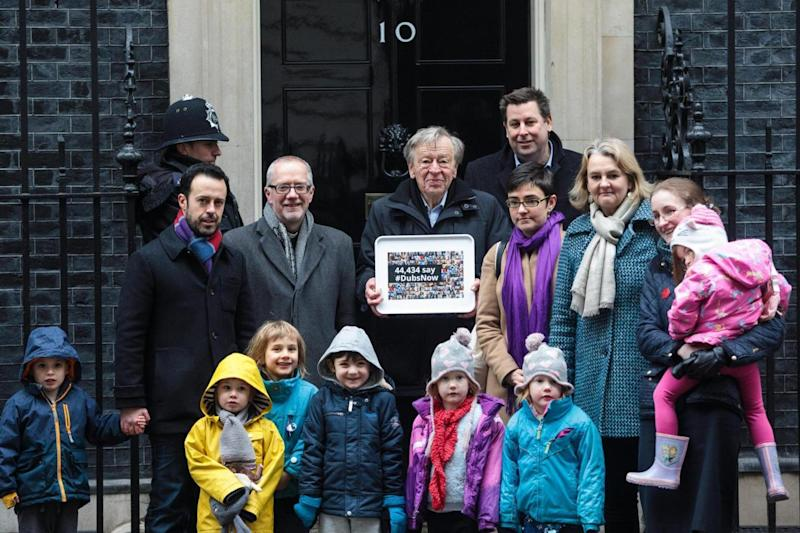 Petition: Lord Dubs delivering petition calling on government to reconsider its decision to end the 'Dubs' scheme (February 2017) (Getty Images)