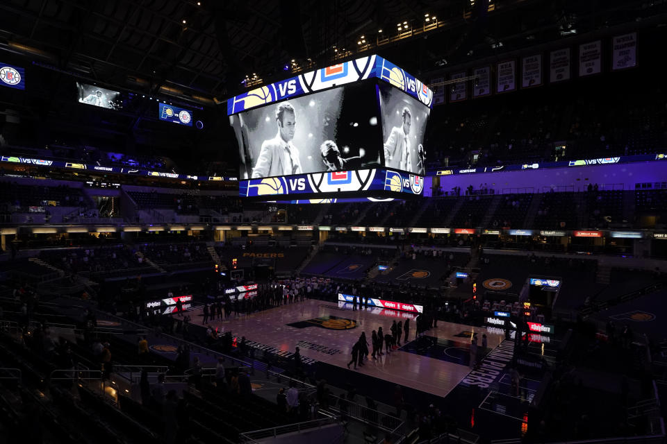 "The Indiana Pacers have a moment of silence for Bobby ""Slick"" Leonard before an NBA basketball game between the Indiana Pacers and the Los Angeles Clippers, Tuesday, April 13, 2021, in Indianapolis. The Indiana Pacers announced that the man who led them to three ABA championships during a Hall of Fame coaching career and was selected a 1963 NBA All-Star had died. (AP Photo/Darron Cummings)"