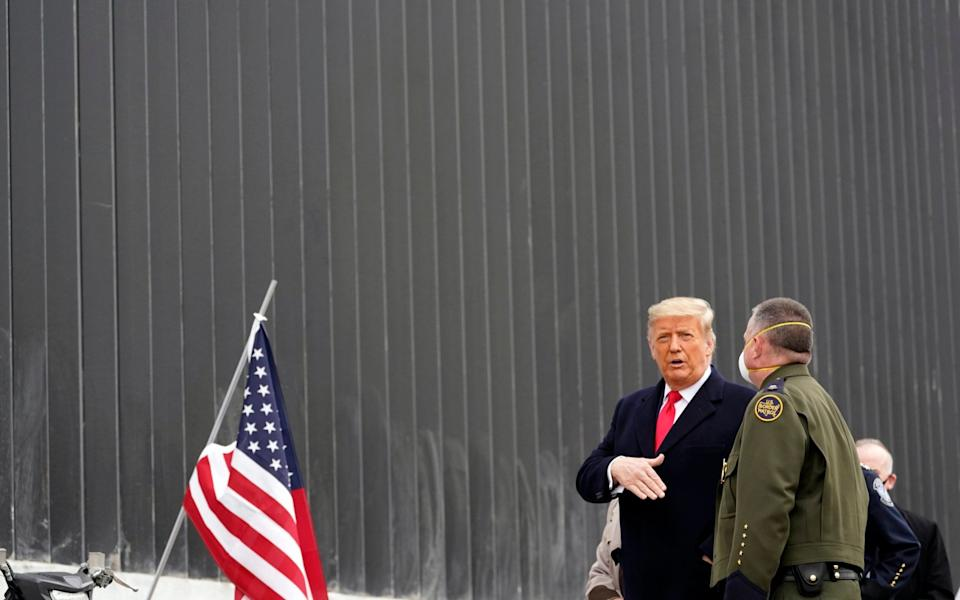 President Donald Trump tours a section of the U.S.-Mexico border wall under construction - AP